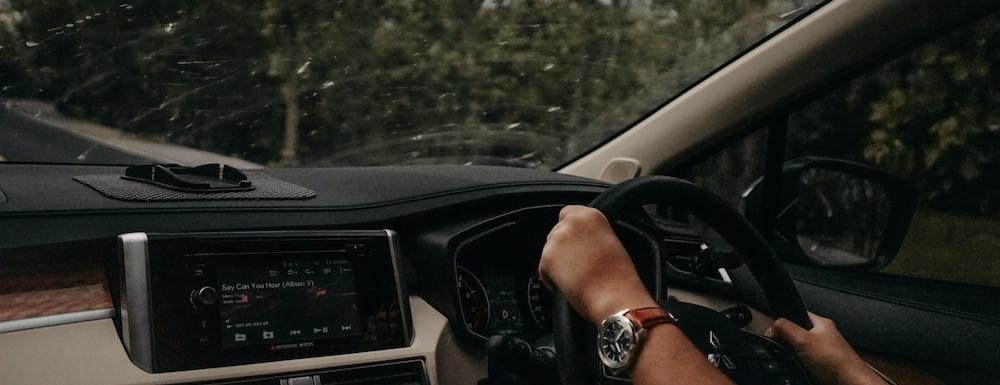 Man wearing a watch driving a car