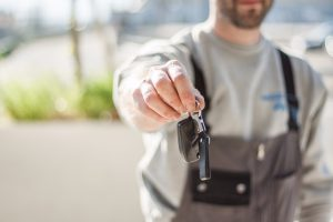 Man holding car keys - 5 different ways to sell your car - Cars Brisbane
