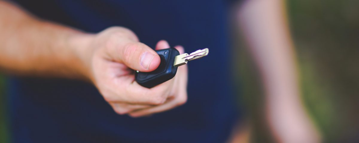 Person holding car key - How to sell a car that needs work - Cars Brisbane