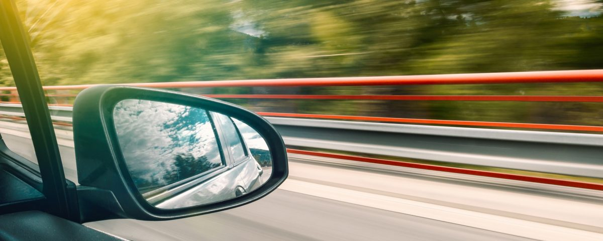Side-view mirror of moving car - The ultimate guide to sell your car