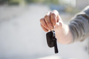Person holding car keys - Selling cars online vs using a dealer - Cars Brisbane