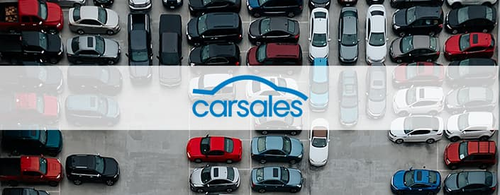 Carsales logo over parked cars image
