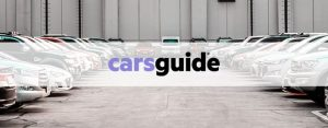 carsguide logo over parked cars
