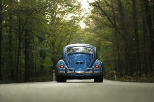 Blue car on road - 10 Things that can hurt your car's resale value - Cars Brisbane