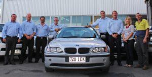 Group of people around car - Cars Brisbane team