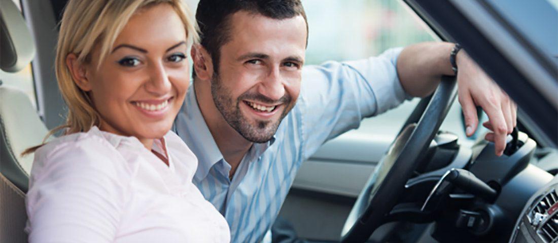 Smiling couple inside of car - Cars Brisbane