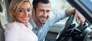 Smiling couple inside of car - Cars Brisbane