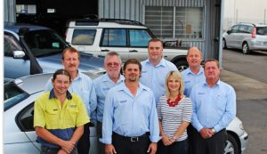 Group of Cars Brisbane employees standing in front of a car - Sell your car